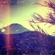 Distressed vintage grungy photo of mountains — Stock Photo #34555167