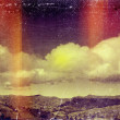 Distressed vintage grungy photo of clouds and mountains — Stock Photo