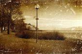 Distressed vintage grungy photo of lantern on a street — Stock Photo