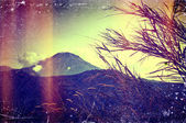Distressed vintage grungy photo of mountains — Stock Photo