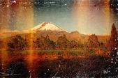 Distressed vintage grungy photo of mountain — Stock Photo