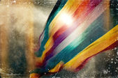Distressed vintage grungy photo of colorful flag — Stock Photo