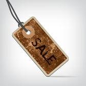 Vector vintage brown weathered cardboard price tag — Stock Vector