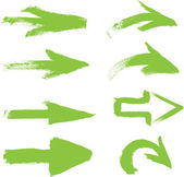 Green vector hand-painted brush stroke arrows collection on black background — Stock Vector