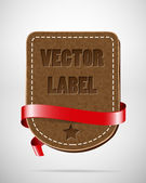 Vector vintage leather badge with red silky ribbon — Stock Vector