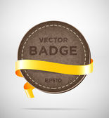 Vector round vintage leather badge with yellow silky ribbon — Stock Vector