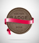 Vector round vintage leather badge with red silky ribbon — Vecteur
