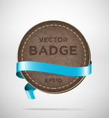 Vector round vintage leather badge with blue silky ribbon — Stock Vector