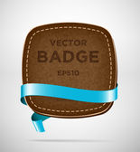 Vector vintage leather badge with blue silky ribbon — Stock Vector