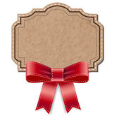 Vintage cardboard old paper retro style label decorated with red silky bow — Stock Vector