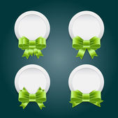 Vector white plastic round badges with green shiny satin ribbon bow knots — Vecteur