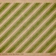 Vector vintage worn out paper card with worn out green striped geometric print — ストックベクタ