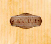 Vintage label tag over old paper background — Vettoriale Stock