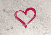 Vector grungy old concrete wall background with hand painted heart — Stock Vector