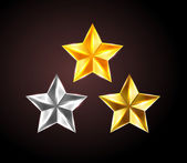 Vector shiny stars: golden, silver and bronze — Stock Vector