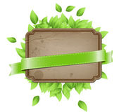 Vector vintage paper - cardboard banner with green leaves — Stock Vector