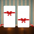 Vector white paper cards with festive silky ribbon bow knots over an old wall background with vintage wallpaper — Stock Vector #36625591