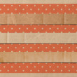 Three folded torn old paper stripes over vintage wallpaper background — Stock Vector