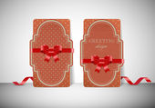 Two vintage cardboard paper greeting cards with silky ribbons and retro patterns — Stockvector
