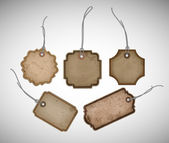 A set of vector old cardboard paper vintage tags — Stock Vector
