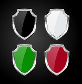 Vector collection of glossy shields with silver steel borders — 图库矢量图片