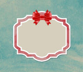 Vintage label tag with satin ribbon bow knot over old paper background — Vettoriale Stock