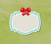Vintage label tag with satin ribbon bow knot over old paper background — Stock Vector