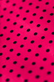 Bright pink dotted vinyl texture background closeup — Stock Photo