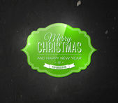 Vector vintage green christmas label on black grungy wall background. — Stock Vector