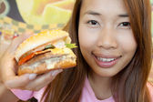 Young woman with Hamburget — Stok fotoğraf
