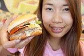 Teen girl with her hamburger — Stock Photo