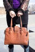 Girl holding a handbag — Stock Photo