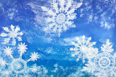 Wintery Holiday Snowflakes Against a Blue Background — Stock Photo