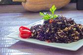 Black rice with tuna and tomatoes — Stock Photo
