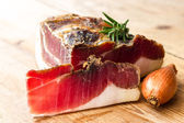 Tasty slices of Italian speck — Stock Photo