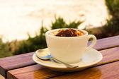 Coffee cream on the beach — Stock Photo