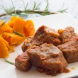 Pork stew garnished with pumpkin — Stock Photo