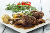 Chicken legs with red wine — Stock Photo