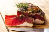 Tasty slices of Italian speck — Stock Photo