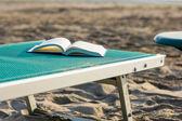 Book on the beach — Stock Photo