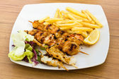 Seafood skewers with chips — Stok fotoğraf