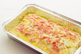 Lasagna with ham and pistachios ready to bake — Stok fotoğraf