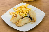 Stuffed cuttlefish and chips — Stock Photo
