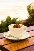 Coffee cream on the beach — Stockfoto