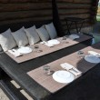 Dining table near the House in the village — Stock Photo