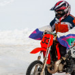 Winter Motocross competitions among children - Stock Photo