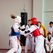 Taekwondo competition between girls — Stock Photo