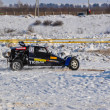 Winter auto racing on makeshift machines — Stock Photo