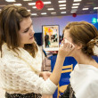 Stock Photo: Makeup artist bring make-up girl