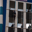 Competitions on fire-applied sport or fire-rescue sport. PENETRATION in 4-floor WINDOW by LADDER ASSAULT. — Stock Photo